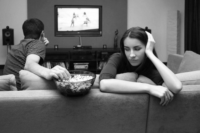 Couple-watching-TV-woman-upset
